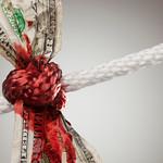 Wrinkled American Dollar Bleeding in Rope