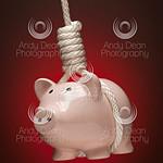 Piggy Bank Hanging in Hangman's Noose on
